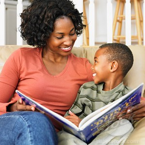 black mom reading with son